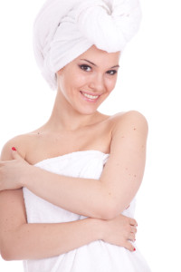 after shower - young woman in white towel on head